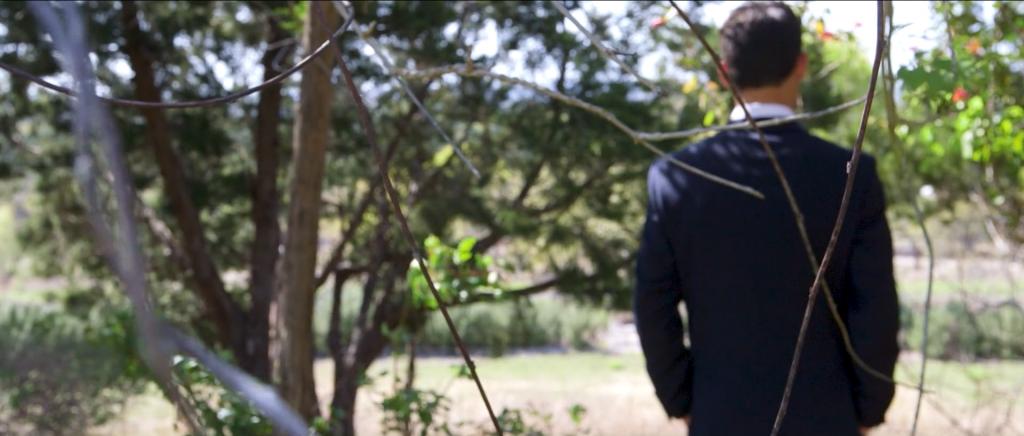 first look austin wedding videographer groom